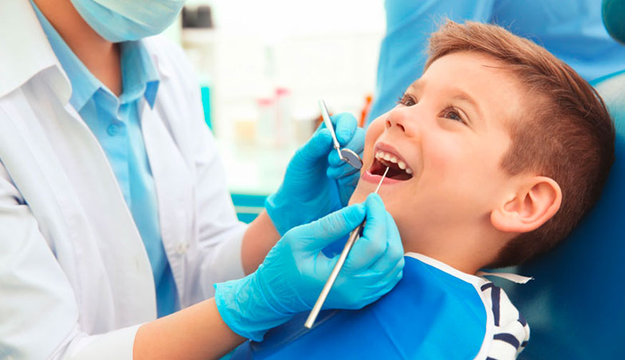 kid on the dental chair